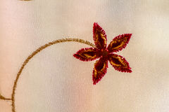 Close up of embroidered flower on fabric Royalty Free Stock Photo