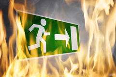 Close-up Of Emergency Fire Exit Board. Burning In The Fire Flame royalty free stock photos