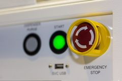 Close up emergency stop button on control panel of machine for safety at factory.  stock image