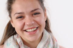 Close up emotional portrait of very happy young girl on white ba Royalty Free Stock Photography