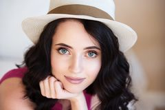 Close-up emotive portrait of young brunette woman with bright fashionable makeup. Royalty Free Stock Photography