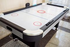 Close up empty air hockey table for playing indoors