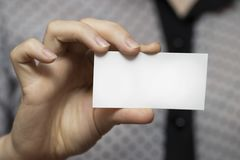 Close-up of an empty business card in a woman`s hand Royalty Free Stock Photos