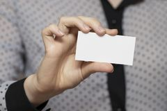 Close-up of an empty business card in a woman`s hand Royalty Free Stock Photo