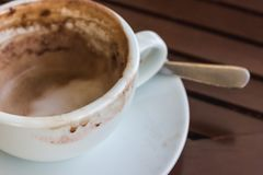 Close up empty coffee cup. After drink on wood table Royalty Free Stock Images