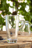 Close up empty glass on wooden table. In restaurant stock photography