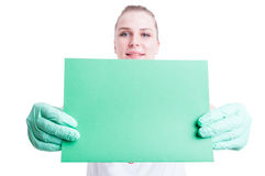 Close-up of empty green card or paper in female doctor hands Stock Images