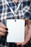 Close-up of an empty id card with a white rope on the female neck. Mockup royalty free stock photos