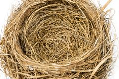 Close up of an Empty Nest.  Focus in the Center of Nest. Horizontal close-up shot of an empty bird`s nest on a white background.  Focus is in the center of the Royalty Free Stock Photography
