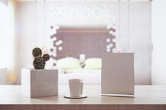 Close up of empty poster. Decorative cactus and coffee cup in blurry bedroom interior with sunlight. Mock up, 3D Rendering Royalty Free Stock Images