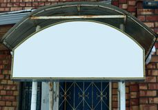 Close up.empty sign above the window of a brick house.  stock photography