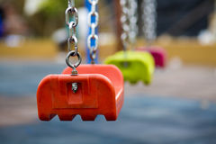 Close up of empty swing in a children play area at park Stock Image