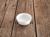 Empty white bowl on wooden table. Close up empty white bowl on wooden table perspective for copy or text stock photography