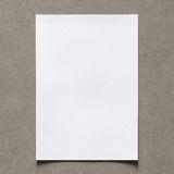 Close up of empty white paper sheet with shadow on vintage wall. Background  for painting, writing, drawing and sketching. Elegant Design with Copy Space for Stock Image