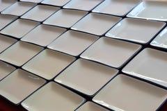 Close-up empty white square dishware ceramics. Stock Photos
