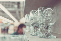 Close up empty wine glasses in the shopping mall. Bali island, Indonesia. stock photo