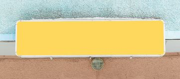 Close up.empty yellow sign on the facade of the house.  stock images