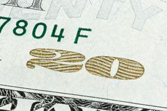 Close-up end stacked of 20 Dollar bill isolated on a white backg. Round royalty free stock image