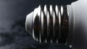 Close-up of energy saving compact fluorescent light bulb.  stock footage