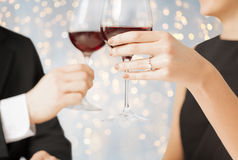 Close up of engaged couple with wine glasses Stock Image