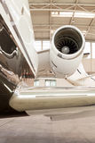 Close up of the engine on a corporate jet. Close up of the engine housing on a small twin-engine corporate passenger jet parked in a hangar at an airport Stock Photography