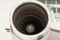Close up of the engine on a corporate jet. Close up of the engine housing on a small twin-engine corporate passenger jet parked in a hangar at an airport Royalty Free Stock Image
