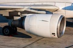 Close-up of engine and main landing gear of passenger aircraft stock photos