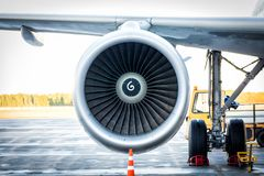 Close-up of engine and main landing gear of passenger airplane royalty free stock images