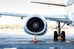 Close-up of engine and main landing gear of passenger airplane stock photos
