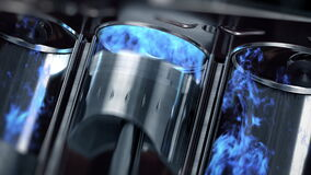 A close-up of engine in slow motion with a blue explosions of fuel