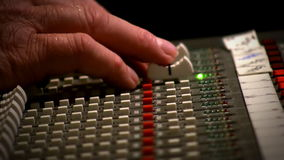 Close up Engineer mixing console recording studio stock video