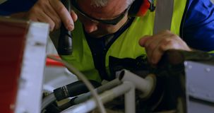 Engineer repairing aircraft engine in hangar 4k stock footage