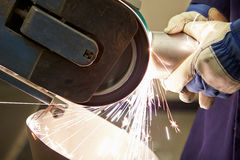 Close Up Of Engineer Using Grinding Machine In Fac Stock Photography