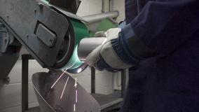 Close Up Of Engineer Using Grinding Machine In Factory Stock Photo