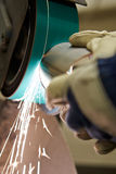 Close Up Of Engineer Using Grinding Machine In Factory Royalty Free Stock Images