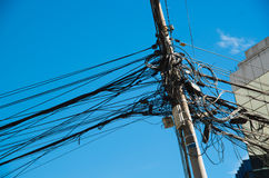 Close up of an entangled power lines in a an beautiful blue sky in the city of Quito Stock Photography
