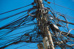 Close up of an entangled power lines in a an beautiful blue sky in the city of Quito Stock Image