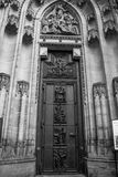 Close up of the entrance to the Gothic Vysehrad cathedral in Prague. Door and portal surrounded by magnificent moldings columns and richly carved Stock Images