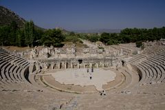 Close Up Ephesus amphitheatre with few tourists beneath and view on harbour street. Near Izmir, Turkey Royalty Free Stock Image