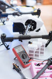 Close up of equipment and drone details. World of technology. Close up of table full of different repairing equipment such as wires and electronic tester and Stock Photo