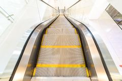 Close up escalator with yellow line in shopping mall. Close up escalator with yellow line inside the  shopping mall Stock Photo
