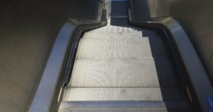 Escalators Down Close Up. Close up of escalators. Moving down to lower floor stock footage