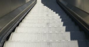 Escalators Down Close Up. Close up of escalators. Moving down to lower floor stock video
