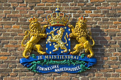 Close-up of escutcheon of the Dutch royal family. Netherlands, Gelderland Province; city; small town Buren: on the wall of the former orphanage, today of the Royalty Free Stock Photography