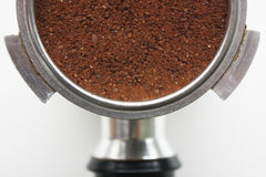 Close-up of an espresso basket full of coffee grounds from above Stock Photography