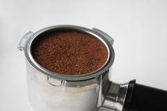 Close-up of an espresso basket full of coffee grounds from the side Royalty Free Stock Photography