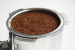 Close-up of an espresso basket full of coffee grounds from the side Stock Photo