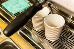 Close-up of espresso pouring from coffee machine Stock Images