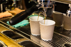 Close-up of espresso pouring from coffee machine Royalty Free Stock Images