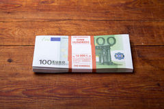 Close-up of  100 Euro banknote. S on wood background Royalty Free Stock Images